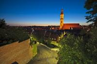 View from the Domberg over the rooftops of the lit up medieval city of Freising in southern Bavaria, Germany.