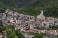 The small medieval village of Luceram in the Provence, France is situated in the center of a lush green valley.