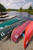 In areas along the banks of the Mersey River in Kejimkujik National Park in Nova Scotia, Canada, there are canoes available to use but rental fees are required.