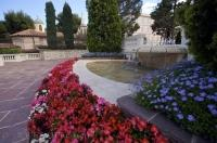 A neatly maintained garden and water feature adorn the grounds at the Ministere d'Etat in Monaco Ville.