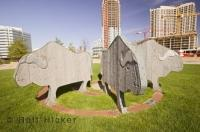 This sculpture is located outside the Mississauga Civic Centre near the Living Arts Centre in Ontario, Canada.