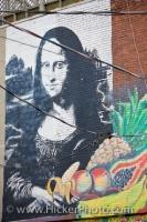 A wall mural on the exterior of a building at the Kensington Market in Toronto, Ontario displays a portrait of Mona Lisa.