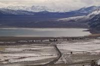 A slightly aerial view of the Mono Lake Basin with the snowcovered Sierra Nevada Mountains behind in California, USA.
