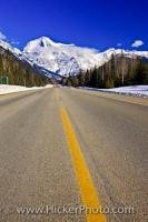 A road called the Yellowhead Highway leads to the beautiful winter scenery of the snow covered Mount Robson. Mount Robson is part of the Mount Robson Provincial Park in British Columbia, Canada.