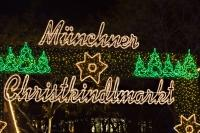 A bright green and white sign saying Muenchner Christkindlmarkt marks the entrance to the Munich Christmas Markets in the city of Munich, Germany.