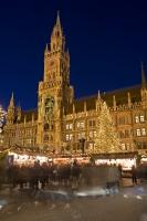 By night the Munich Christkindlmarkt, Christmas markets which are setup in the Marienplatz every December, transforms into a hive of activity as visitors browse the many market stalls for gift ideas and supplies.