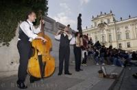 The entrance to Prague Castle in the Czech Republic can become very busy before opening and this musical group keeps the visitors happy while waiting.