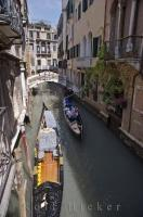 A ride in one of the famous gondolas along the narrow, side canals of Venice, Italy can be just as interesting as the Grand Canal journey.