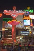 The famous Las Vegas Strip is lit up by many neon signs, advertising the endless possibilities for entertainment and attractions available and vying eagerly for the attention of passersby.