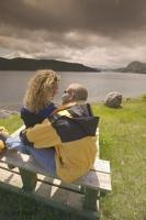 Stock photo of a romantic couple enjoying the vista at Gros Morne National Park along the Viking Trail