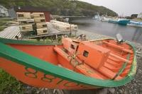A local fisherman leaves his fishing boat on the shore in Newfoundland, Canada.