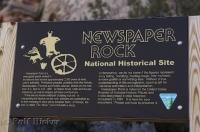 A sign which gives some information about the petroglyphs on Newspaper Rock near Canyonlands National Park.