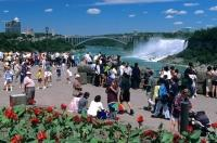 Tourists flock to Niagara Falls to have a closer look at the American and Horseshoe Falls in Ontario, Canada.