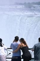 Niagara Falls in Ontario, Canada brings in thousands of tourists annually such as this romantic couple overlooking the Horseshoe Falls.