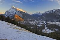 The road up Mt Norquay to the ski resort is one of switch backs but great viewpoints. A few kilometres from the interchange is a meadow clearing which offers a great view of the town of Banff and surrounding mountains.
