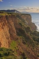From the top of the Whitecliffs at the North Taranaki Bight in New Zealand, one can see the formations in the cliffs and admire the scenery for miles along the rugged coastline.