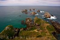 The nuggets of rocks which give Nugget Point in the Catlins region of the South Island of New Zealand its name. Once part of the small peninsula, these islands have been worn down over time by the elements.