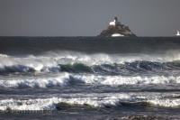The constant ocean current swirls around the base of Tillamook Head and Lighthouse in Oregon, USA.