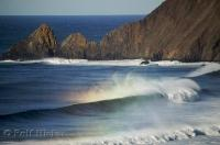 The mighty Pacific Ocean waves roll into shore near the Ecola State Park in Oregon, USA.