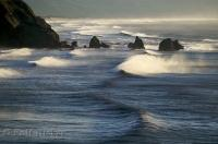 A strong wind blows against the Pacific Ocean rollers creating waves of storm proportions along the Oregon Coast, USA.