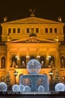 The Old Opera House in Frankfurt, also known as the Alte Oper Frankfurt is lit up at dusk with its fountain in front in downtown Frankfurt, Hessen, Germany. This historical building is very central in the town and is well worth a visit.