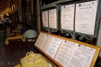 Menus adorn the wall of an Old Town Street Cafe in Nice, Provence in France, Europe.