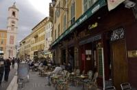 In the Old Town district of Nice in Provence, France, many visitors sit on the outside terraces of street cafes and watch the world go by.