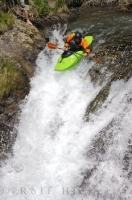 A kayaker launches himself over the brink of Sauth deth pish in the Val d'Aran, a great place for outdoor adventures in Catalonia, Spain.