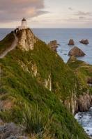 Set high up on a rocky point, the Nugget Point lighthouse overlooks the rugged coastline of the South Pacific Ocean in the Catlins region of NZ.