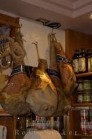 The famous Parma ham hanging on display in the city of Venice, in Veneto, Italy in Europe.