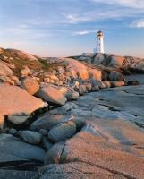 Peggy's Cove Lighthouse in Nova Scotia at sunset