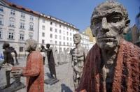 People sculptures by Olbram Zoubeck Sochy are on display for all visitors to see in the Old Town section of Prague in the Czech Republic. Olbram Zoubeck is a very famous Czech artist who has his work on display throughout the country.