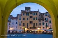 View of the old Roman Amphitheatre in the Piazza Anfiteatro at dusk, in the city of Lucca, in the Province of Lucca, in the Tuscany Region of Italy. Lucca is the capital city in the Province of Lucca.