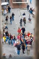 Tourists have places to go and things to do while visiting the Piazza di San Giovanni in the city of Florence, Italy.