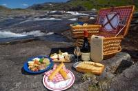 Enjoying a meal out of a picnic hamper surrounded by the tranquility, the Mealy Mountains and a waterfall is what makes up some of the region of Southern Labrador in Newfoundland Labrador.
