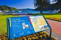 The tastefully landscaped foreshore in the town of Picton is a beautiful place to sit and watch sailboats tugging gently against their moorings or ferries plying the blue waters of Queen Charlotte Sound in Marlborough, New Zealand.