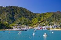Boats line the waterfront and harbour of the small town of Picton located on the South Island of New Zealand.