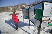 A tourist checks out the information about a Alaska Pipeline viewpoint near Fairbanks, Alaska, USA.