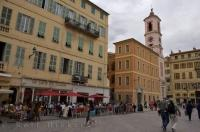 A typical cafe and street scene in Place du Palais where tourists love to explore in the Old Town of Nice, a City in the Cote d'Azur in Provence, France.