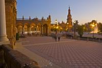 A famous tourist attraction in Seville, Spain is the Plaza de Espana with its amazing architecture, which is especially beautiful at sunset and dusk.