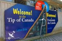 The large blue sign around the wooden building, welcomes visitors to Point Pelee National Park in Leamington, Ontario,.