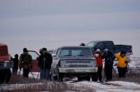 People attending a photo workshop have come to the Churchill Wildlife Management Area in Churchill, Manitoba to capture a Polar Bear on film.