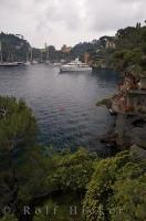 Luxury yachts line the harbour of Portofino on the Italian Riviera in Liguria, Italy.