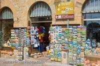 These busy shop windows in the city of Volterra in Tuscany, Italy display souvenirs of the area.