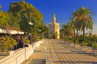 Along the promenade leading towards the Tower del Oro are many restaurants and street cafe's, mixed with locals and tourists, Seville, Spain.