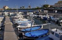 Fishing boats line the docks at the marina in Sausset Les Pins in the Provence, France in Europe.
