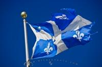 With a blue background the Provincial flag of Quebec is decorated with a white cross reminiscent of the royal flags of France, and four Fleurs-de-lys - symbols of purity that were originally representative of the Virgin Mary.