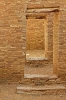 A series of doorways provide access through the thick walls of Pueblo Bonito at the Chaco Culture National Historic Park in New Mexico.