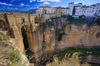 The Puente Nuevo, meaning the New Bridge in Spanish, spans the El Tajo Gorge and the Rio Guadalevin river within the town of Ronda in the gorgeous Costa del Sol region of Malaga. This is located in Andalusia in Spain.