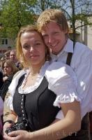 A traditionally dressed couple enjoy the celebrations of the Maibaumfest in Putzbrunn, Germany.